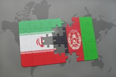 puzzle with the national flag of iran and afghanistan on a world map background. Royalty Free Stock Images