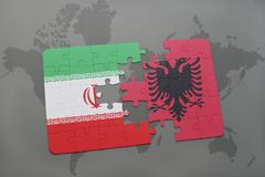 puzzle with the national flag of iran and albania on a world map background. Royalty Free Stock Photos