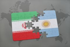 Puzzle with the national flag of iran and argentina on a world map background. Stock Photography
