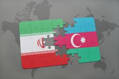 puzzle with the national flag of iran and azerbaijan on a world map background. Stock Images