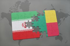 puzzle with the national flag of iran and benin on a world map background. Royalty Free Stock Photography