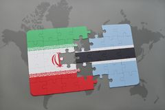 Puzzle with the national flag of iran and botswana on a world map background. Royalty Free Stock Photo