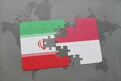 Puzzle with the national flag of iran and indonesia on a world map background. 3D illustration Stock Photos