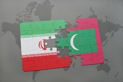 Puzzle with the national flag of iran and maldives on a world map background. 3D illustration Stock Images