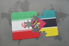 Puzzle with the national flag of iran and mozambique on a world map background. 3D illustration Royalty Free Stock Photography