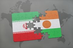 puzzle with the national flag of iran and niger on a world map background. Royalty Free Stock Photography