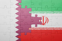 Puzzle with the national flag of iran and qatar Stock Photos
