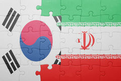 Puzzle with the national flag of iran and south korea. Concept stock photos