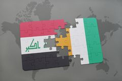 Puzzle with the national flag of iraq and cote divoire on a world map background. 3D illustration Royalty Free Stock Photo