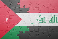 Puzzle with the national flag of iraq and jordan Royalty Free Stock Image