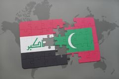 Puzzle with the national flag of iraq and maldives on a world map background. Royalty Free Stock Photo