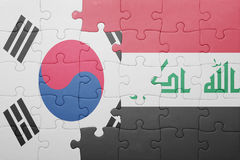 Puzzle with the national flag of iraq and south korea. Concept royalty free stock images
