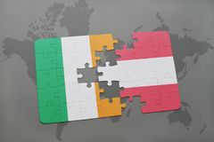 Puzzle with the national flag of ireland and austria on a world map background. 3D illustration Stock Photos