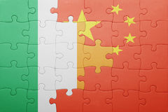 Puzzle with the national flag of ireland and china. Concept Royalty Free Stock Photos