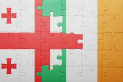 Puzzle with the national flag of ireland and georgia Stock Photos