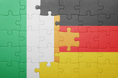 Puzzle with the national flag of ireland and germany. Concept Stock Photography