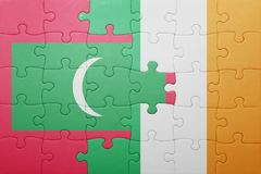 Puzzle with the national flag of ireland and maldives Stock Photos