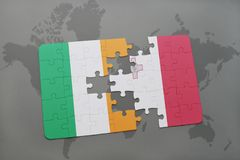 Puzzle with the national flag of ireland and malta on a world map background. Stock Photo