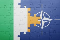 Puzzle with the national flag of ireland and nato. Concept royalty free stock photos