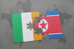 Puzzle with the national flag of ireland and north korea on a world map. Background. 3D illustration royalty free stock photos