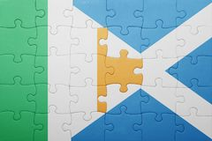 Puzzle with the national flag of ireland and scotland. Concept royalty free stock image