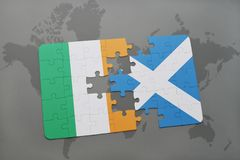 Puzzle with the national flag of ireland and scotland on a world map background. 3D illustration Royalty Free Stock Images
