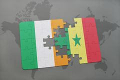 puzzle with the national flag of ireland and senegal on a world map Royalty Free Stock Photo