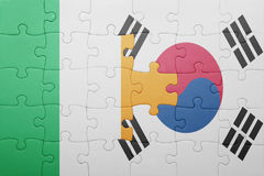 Puzzle with the national flag of ireland and south korea. Concept royalty free stock image