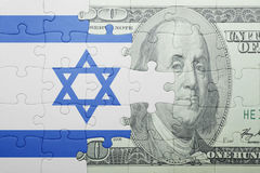 Puzzle with the national flag of israel and dollar banknote Royalty Free Stock Photo