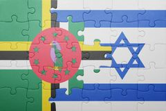 Puzzle with the national flag of israel and dominica. Concept stock photos