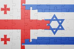 Puzzle with the national flag of israel and georgia. Concept Stock Image