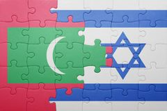 Puzzle with the national flag of israel and maldives Stock Images