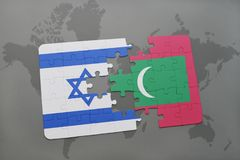 Puzzle with the national flag of israel and maldives on a world map background. Royalty Free Stock Image