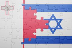 Puzzle with the national flag of israel and malta. Concept Stock Photography