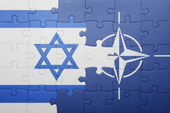 Puzzle with the national flag of israel and nato Royalty Free Stock Photography