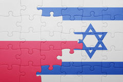 Puzzle with the national flag of israel and poland. Concept Royalty Free Stock Photos