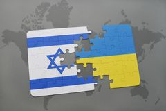 Puzzle with the national flag of israel and ukraine on a world map background. Royalty Free Stock Photo