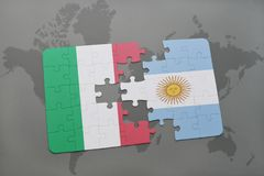 Puzzle with the national flag of italy and argentina on a world map background. Royalty Free Stock Images