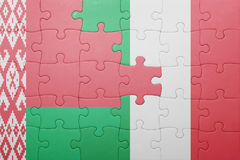 Puzzle with the national flag of italy and belarus Royalty Free Stock Photography