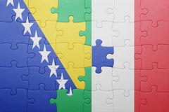 Puzzle with the national flag of italy and bosnia and herzegovina Royalty Free Stock Photography