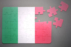 Puzzle with the national flag of italy Stock Photography