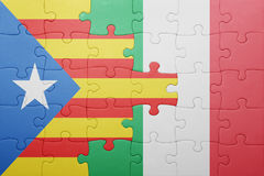 Puzzle with the national flag of italy and catalonia Royalty Free Stock Photos