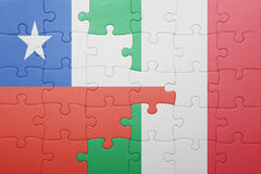 Puzzle with the national flag of italy and chile Stock Images