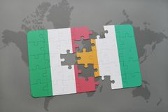 Puzzle with the national flag of italy and cote divoire on a world map background. 3D illustration Stock Photos
