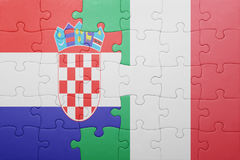 Puzzle with the national flag of italy and croatia Royalty Free Stock Photos