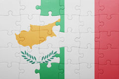 Puzzle with the national flag of italy and cyprus Stock Photo