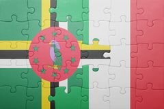 Puzzle with the national flag of italy and dominica. Concept royalty free stock photos