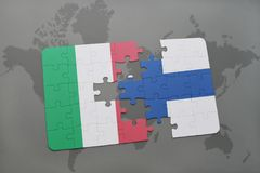 Puzzle with the national flag of italy and finland on a world map background. 3D illustration Royalty Free Stock Image