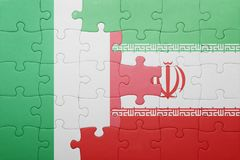 Puzzle with the national flag of italy and iran Stock Photo