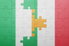 Puzzle with the national flag of italy and ireland Royalty Free Stock Photo